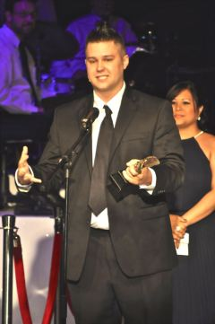 "Hunter McMahon, seen above, accepts his award of the 2013 Best Minor Actor in a Musical for his role as Teen Angel in ""Grease,"" directed by Travis Bryant. He has won two Montie Awards overall including one for Best Lead Actor in a Musical in 2012."